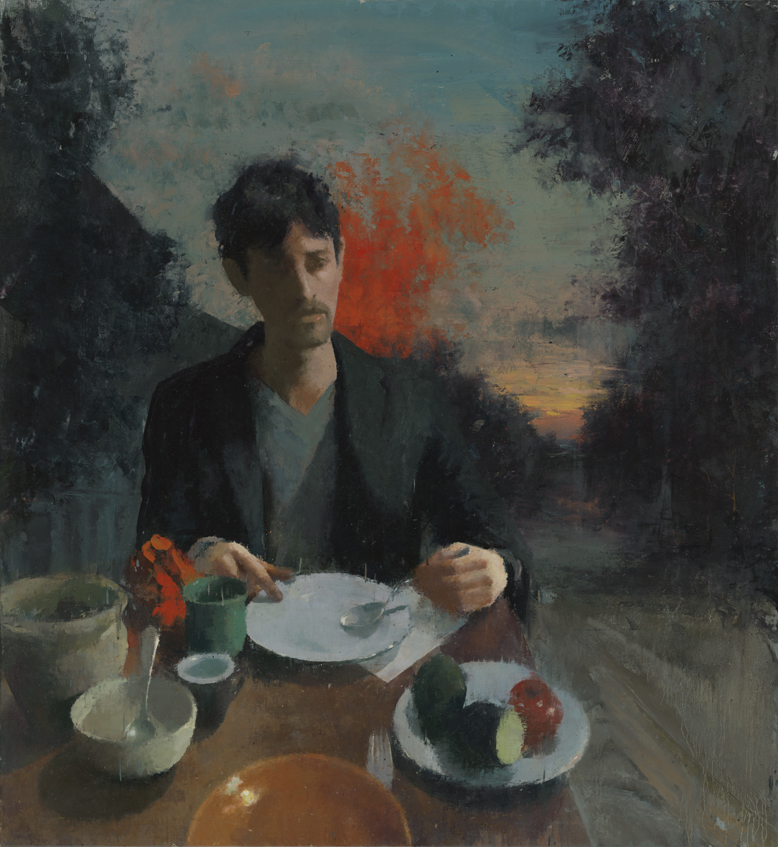 Self portrait at a table