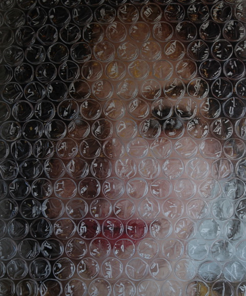 Image #2 of Sophia behind bubble wrap